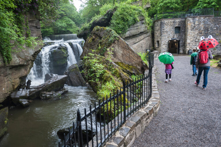 Aberdulais Visitors With Brollies 768x512
